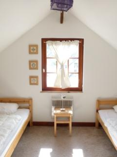 Bright twin room with space for a travelcot