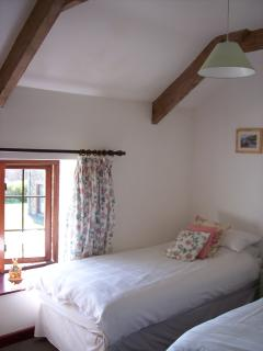 Pretty twin bedroom with veiws across the lawned area to the wood beyond