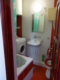 bathroom with tab and washing machine