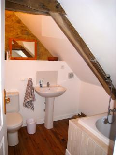 Loft bathroom with tub and loo