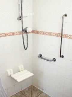 En suite shower room suitable for the less able/wheelchair users