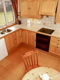 Spacious and well equipped kitchen with fridge freezer, dishwasher, oven and hob