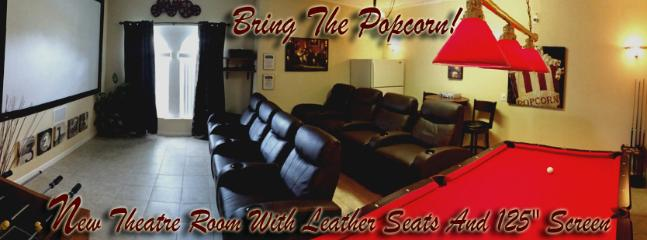 Theatre Room with 10 foot screen and multi level leather theatre seating!