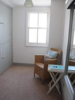 Dressing Room with lots of storage, iron and ironing board