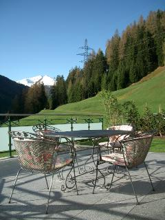 sunny patio with lovel view of mountains and countryside