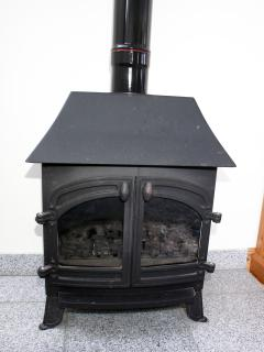 Gas burner for colder days to supplement full central heating