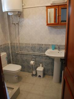 the shower has glass sliding doors and an extra large boiler for plenty of hot water