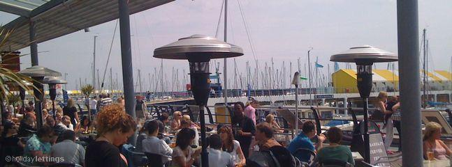 Brighton Marina, enjoy Al fresco eating at one of its many restaurants.