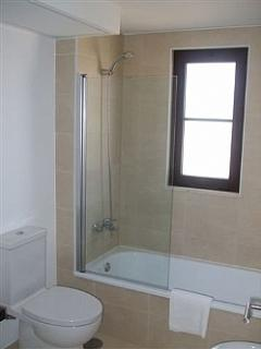 Bathroom in the apartment with bath and shower/screen