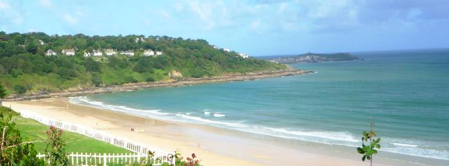 Carbis Bay beach below the cottage with the view of the cliff path leading to St Ives