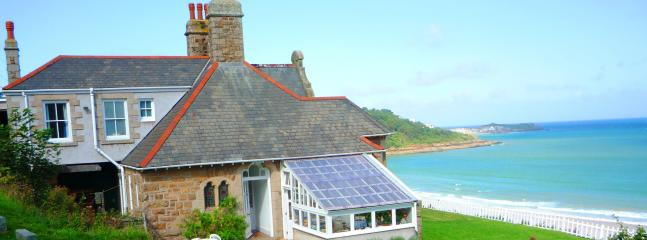 View of cliff cottage facing the bay towards St Ives