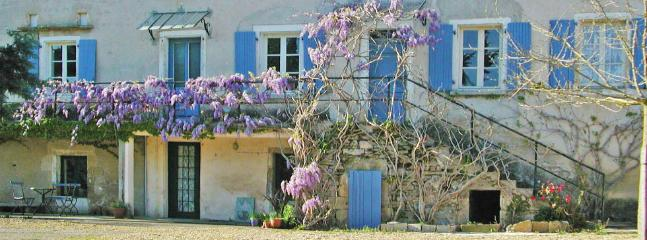 Wysteria flowers covering the main guesthouse in Spring.