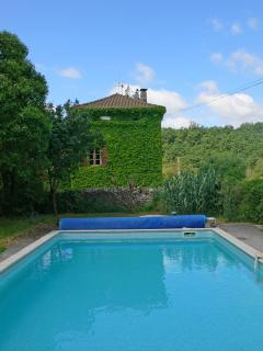 The pool and neighbouring farmhouse beyond, the pool has beautiful views over the surrounding countr
