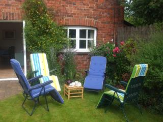 Relax in our private, sheltered garden.