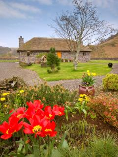 Spring view of Clan MacDougall cottage No.3