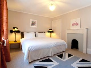 Spacious bedroom with period features, a super king size bed and Egyptian cotton linen.