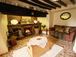 Cosy homely lounge with inglenook fireplace logs and coal included