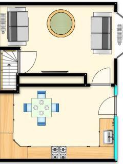 Ground floor layout - lounge and kitchen with door onto the courtyard garden