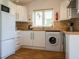 Kitchen with full size fridge freezer, washing maching and double oven with ceramic hob