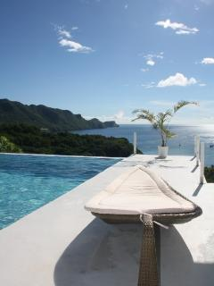 Sun Lounger And Infinity Pool