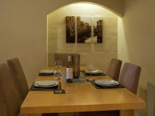 Dining area with a beautifully lit alcove feature wall