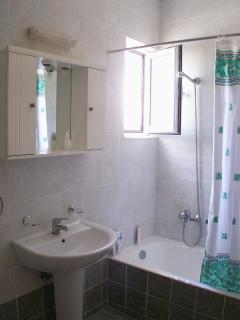 and attached bathroom (with bath and overhead shower)