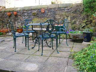Space to sit and relax outside - comfy cushions provided!