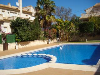 Enjoy the communal pool with plenty of space for soaking up the sun