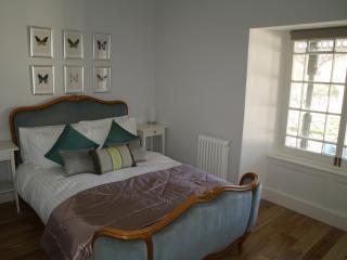 Master bedroom with antique Louis bed & en-suite