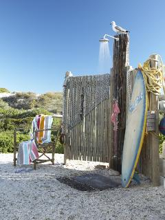 Outdoor shower. Rinse off after a swim at the blue flag beach. Enjoy fishing, surfing or boating.