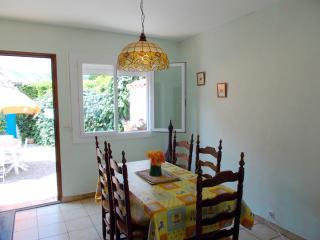 Bright dining room with door to garden