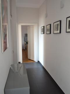 The hallway looking down to the kitchen