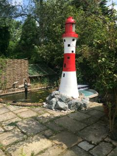 The hot tub at the bottom of our replica beachy head light house next to the pond.