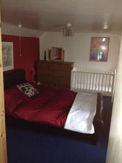 Large double bedroom with sea views & cot