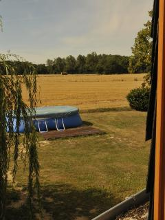 The view of the pool and the loire valley beyond from the south facing master bedroom - Le Bois