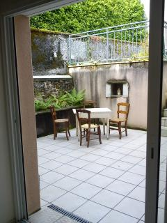 Back Terrace leading directly from the main living room. Great spot for a barbecue.