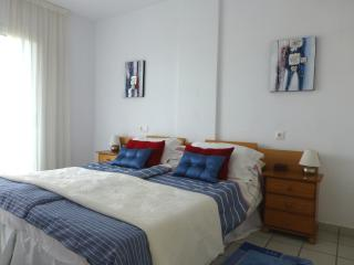 main bedroom with access to balcony, with ensuite