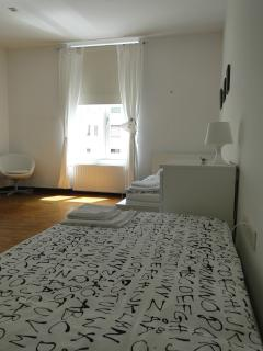 Bedroom with two single beds that can be pulled together.