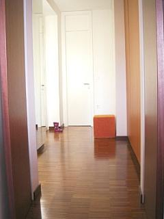 Bright entrance hall has an automatic light, so you never enter the apartment in darkness.