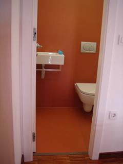 A separate toilet near the entrance is really convenient and private.