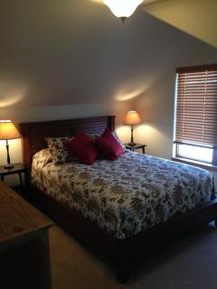 Upstairs bedroom has queen bed with great views of Byers Peak.