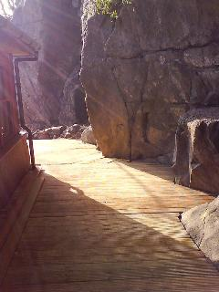 Decking by rock face.