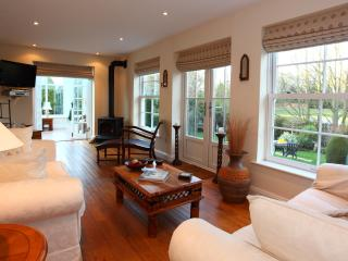 Beautiful oak-floored lounge looking out onto gardens