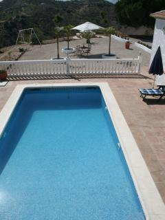 The pool and the terrases overlooked from the upperterras