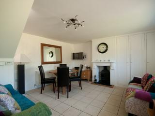 Comfortable sitting area with wall mounted TV and lots of storage