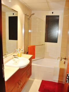 The En-suite bathroom including Shower/Screen over bath, toilet, sink, mirror, shaver point, bidet