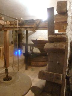 Grain hoppers and grinding stones