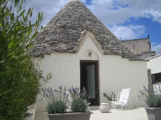 The Olive tree Trullo near the city centre of Alberobello