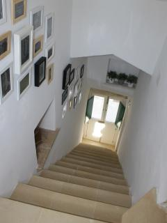 Staircase leading from front door up to living area