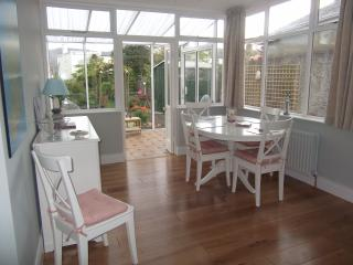 Open plan dining hall leading to conservatory